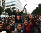 Tunisians shout slogans during a demostration against the government and price hikes on January 9, 2018 in Tunis.  Protests hit several parts of Tunisia where dozens of people were arrested and one man died in unclear circumstances amid anger over rising prices, authorities said. / AFP PHOTO / FETHI BELAIDFETHI BELAID/AFP/Getty Images